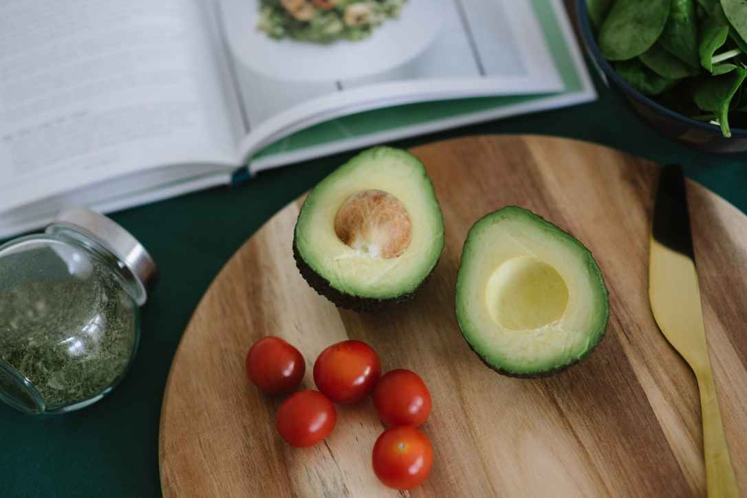 sliced avocado on brown wooden board